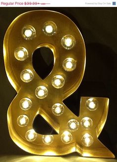 A personal favorite from my Etsy shop https://www.etsy.com/listing/218785472/8-lighted-marquee-sign-letters-ampersand