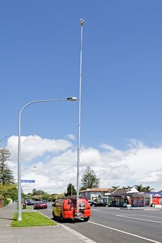 One is a power pole; the other a 20 metre high Open2view photo pole.