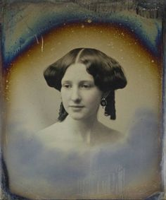 Unidentified woman by Southworth & Hawes, early 1850's. Extreme rolls extended above or mid ears, sausage curls behind.