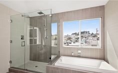 neutral bathroom with a view of SF