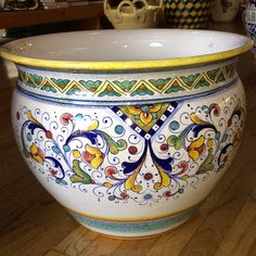 Italian ceramic planter or pot hand made and hand painted from Deruta in Italy. This Italian pottery planter is 16.25'' D x 13'' H and can be found at the Italian Pottery Outlet.