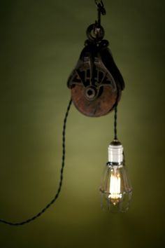 a way to use the pulley from the old family farm! 1181 Pulley Light Hanging from Vintage Chain. i love this idea Funky Lighting, Rustic Lighting, Vintage Lighting, Pully Light, Rustic Hardware, Vintage Light Fixtures, Antique Lamps, Lampshades, Hanging Lights