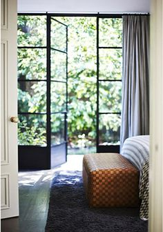 love those glass doors with the black frames