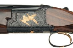 ... Gold Highlighted Browning Citori Grade VI Over/Under Shotgun with Case