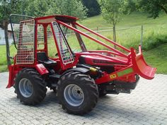 Alpine tractors come from Europe where they are used for working on steep sided hills and in mountainous forests.