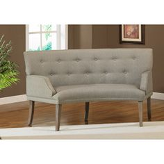 The Hilton Curved Graphite Loveseat. Two of these across from one another in the bar area with a little circular table in the middle could be super cute. Plus, it would be space saving too.