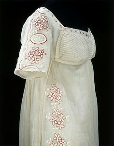 "Here's another Regency for everyone! This dress is from 1808. Made of muslin, it is lined in linen and embroidered in wool in a variety of stitches. The cut of the bodice is called a drop-front, forming a sort of ""bib"" where the sides where fastened underneath and the top piece pinned or buttoned over it, hiding it all. This dress is in the V Museum."