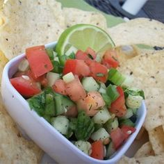 Cool Cucumber Salsa Recipe Appetizers with cucumber, tomatoes, chopped green bell pepper, jalapeno chilies, onions, garlic, lime juice, fresh parsley, fresh cilantro, dried dillweed, salt, tortilla chips