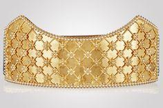 Sarah Burton's gold-tone leather waist belt gives Alexander McQueen an Elizabethan sheen
