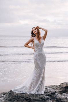 This Ariel-inspired wedding gown is playful, yet elegant. A subtle flared train is reminiscent of a mermaid's silhouette, while sparkling sequins mimic the play of light across the moonlit sea. Disney Wedding Dresses, Wedding Dress Sizes, Designer Wedding Dresses, Disney Weddings, Gown Gallery, Bridal Gallery, Disney Collection, Bridal Collection, Dress Collection