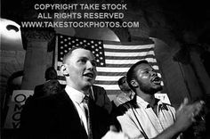 TAKE STOCK photo. Political rally at Tougaloo College near Jackson. Mendy Samstein and Charles McLauren, SNCC organizers, singing freedom songs.