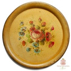 Exciting Antique Paris Saffron Gold Tole Peinte Round Tole Tray decorated with an exceptional floral bouquet with one large pink apricot rose, sweet rosy red marguerites {daisies}, pink rosebuds and blue little country garden flowers. Stunning painting by an accomplished artist make this an heirloom tray to desire. The background is that soft French saffron yellow aged to a gold glow we love, with craquelure. This tray has it all, age, beauty, probably lots of stories to tell. Gilt hand p