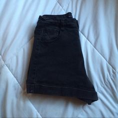 "brandy - caiden shorts brandy melville high waist faded black denim shorts. the denim is extremely thick and soft. worn and washed. love these but they got too cheeky for me :) waist measures 24"" exactly. may trade for AA shorts only. Brandy Melville Shorts Jean Shorts"