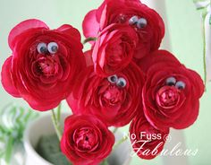 I've never thought of/seen this before. Wonderland roses from squiggly eyes. Genius!!!