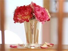 one at each place setting - doubles as wedding favor and as floral arrangements