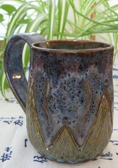 Cool mug - chun plum over blue rutile and verte lustre on the botton