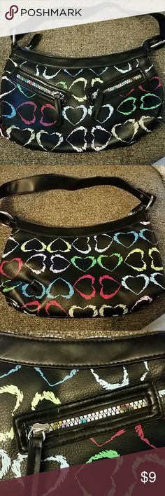 Black purse with hearts manuf unknown Super cute purse and lm not a purse person.  I dont believe it has been used.  Has a zipper pocket and a small cell phone pocket inside.  The zippers are multicolored. Bags