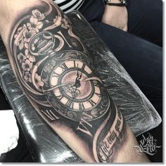 pocket watch black and gray tattoo on forearm