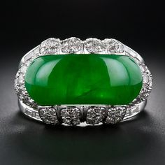 A large and impressive, deep translucent green, saddle-shape natural-color jadeite ring. The vibrant jade saddle is lavishly presented in a handmade platinum mounting with diamond-set scallops and double-tiered shoulders with shimmering baguette Jade Jewelry, Jewelry Rings, Jewelery, Le Jade, Antique Jewelry, Vintage Jewelry, Imperial Jade, Jade Ring, Gems And Minerals