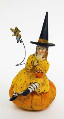 """Debbee Thibault Little Miss Muffet Sat on her Pumpkin    With a fairy instead of a spider, and a pumpkin instead of tuffet, a young witch enjoys her bowl of Halloween goodies. This noted artist has been copied by many, but holds the distinction of creating the most coveted and appreciable of folk artist's figurines. Each is created by hand in the US, replicated in exacting likeness to an antique design. 6.5""""."""
