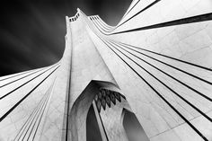 """From a series of fine art black and white photographs showing the unique beauty and architectural detail of the symbol of Tehran, Azadi Tower, Iran. Azadi Tower is a post-modern architecture designed by Iranian-Canadian architect """"Hossein Amanat """" in 1971 to commemorate the 2500th anniversary of the first Persian empire."""