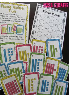 Place value centers - students take base 10 cards and write the number