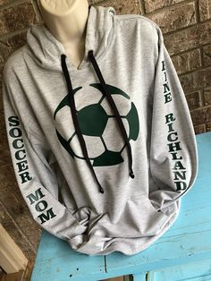 Show some FUN support and keep warm at those tournaments! Customize colors for your favorite player or team! Super soft light weight sweat shirt with hood and kangaroo pouch. * Unique Soccer design on the front in whatever color you would like and Soccer Moms, Soccer Mom Shirt, Soccer Pro, Soccer Gear, Girls Soccer, Soccer Players, Soccer Drills, Live Soccer, Soccer Stuff