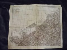 Map on silk handkerchief issued by the War Office to the RAF. Different map on each side. Thierry de Maigret