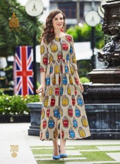 Get a dose of freshness with this multicolor tunic, printed all over in lawn cotton. With a front slit and yoke detailings, the design is a perfect pick. Kurta Designs Women, Kurti Neck Designs, Salwar Designs, Kalamkari Dresses, Ikkat Dresses, Cotton Tunics, Cotton Dresses, Indian Dresses, Indian Outfits