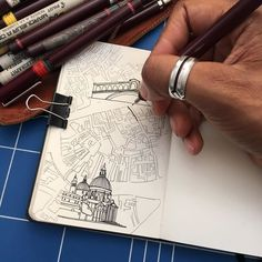 Can you guess which city I'm drawing here in my Moleskin sketch book? My maps start out as pencil ketches before being inked up and colored.