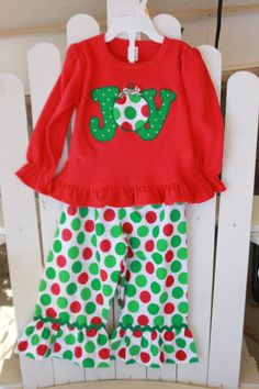 This is a ruffle pant set.the shirt is MONAG brand months with JOY appliqued on the front. The O is an ornament with a christmas ribbon at Girls Christmas Outfits, Holiday Outfits, Christmas Clothing, Christmas Shirts, Children's Boutique, Girls Boutique, Boutique Clothing, Little Girl Outfits, Cute Outfits For Kids
