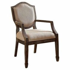 """Perfect pulled up to your dining table or writing desk, this wood arm chair showcases taupe upholstery and a shield-style back.   Product: ChairConstruction Material: Solid wood and microfiberColor: Grey and taupeFeatures:19.25"""" Seat height Dimensions: 39"""" H x 23"""" W x 26.75"""" D"""
