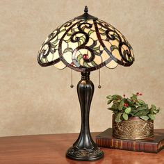 A rich blending of color and a shapely, captivating form make the YaVonne Stained Glass Lamp a perfect tabletop luminary. Table lamp features a dark brown. Cool Lamps, Unique Lamps, Stained Glass Table Lamps, Best Desk Lamp, Large Lamps, Rustic Lamps, Bedroom Lamps, Decoration, Floor Lamp