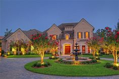We are IN LOVE with this circular, stone driveway! With the added lights surrounding it!