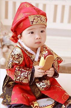 Baby boy's hanbok. Hanbok (South Korea) or Chosŏn-ot (North Korea) is the traditional Korean dress. It is often characterized by vibrant colors and simple lines without pockets.