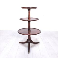 Mahogany Tiered Display Shelf. - Mahogany three-tiered vintage display table with brass feet- Good condition overall