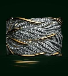 Beautiful Jewelry Flowing gold and platinum leaves twist around the wrist, accentuated with brilliant diamonds. - Browse The 2017 Blue Book Diamond Jewelry, Gold Jewelry, Jewelry Box, Diamond Necklaces, Diamond Bangle, Gold And Diamond Bracelets, Glass Jewelry, Jewelry Ideas, Jewelry Making