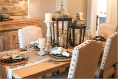 Love the lanterns and candlesticks mixed together on this dining room table