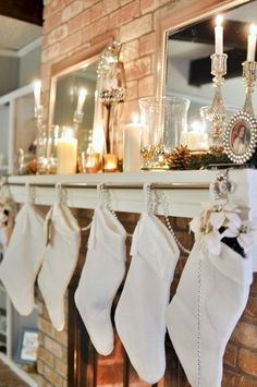 LOVE THIS IDEA!!  Hang decorative curtain rod from weighted stocking holders, then hang stockings from rod.