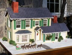 A gingerbread version of the Griswold house from National Lampoon's Christmas Vacation features a sugar lawn ornament, a Christmas tree crashing through the front window, and a roof that lights up. By Elizabeth Hodes Custom Cakes and Sugar Art. (Seriously, this woman is my hero.)