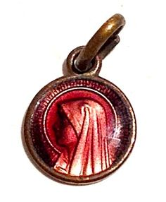 Tiny Antique Medal Pink Purple Enamel Virgin Mary Charm (Image1)Tiny Rare vintage pink and purple enamel holy medal charm featuring The blessed mother Virgin Mary as Our lady of Lourdes. Perfect for a charm bracelet or Christening, Baptism, Communion, Confirmation or newborn baby gift.