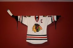 I am so going to do this. Hockey Valance Holder, Jersey Display, or Stick Display. $25.00, via Etsy.