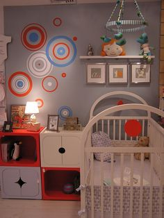 This is a fun and fairly nuetral nursery design. Eclectic and easy to do!