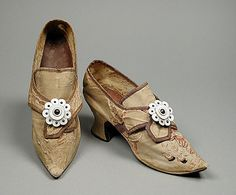 Women's wedding shoes, English, c. 1740's. Made of brocaded silk, leather, linen, and kid leather, with buckles made of conch shell and brass.