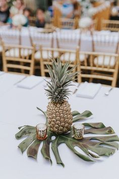 Minus the pineapple and add gold mini dinosaurs. Tropical wedding centerpiece idea - palm leaf and pineapple centerpiece {Kpix photography} Tropical Candles, Tropical Wedding Centerpieces, Bridal Shower Centerpieces, Flower Centerpieces, Wedding Decorations, Centerpiece Ideas, Tropical Wedding Decor, Tropical Weddings, Table Decorations