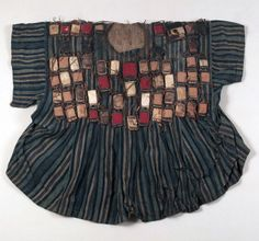 Africa | Warrior's robe from the Dagomba people of Togo | Cotton; strip weave, warp striped.  Leather amulets, fur and snake skin | ca. 1902.