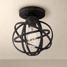 """Industrial Atom 8"""" Wide Edison Bronze Ceiling Light Went to the store to take a look at his one, cute but too small."""