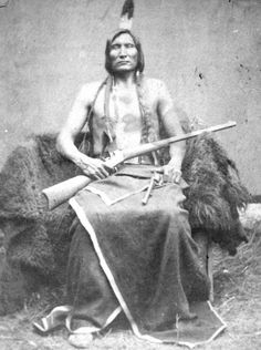 Touches The Cloud- (Mineconjou) The picture was taken in 1877. He was a half brother to Chief Spotted Elk and he was best known as Crazy Horse's main warrior-He was the cousin of Crazy Horse and a chief of the Warrior Society.