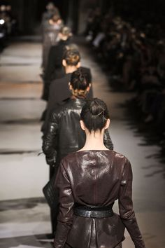 Haider Ackermann gives good jacket.  The back of the one closest to the camera is astonishingly complex for all its seeming simplicity. Not unlike soft armor, the feminine lines of the jacket elevate it and the girl wearing it beyond model and into Icon. Rock on.