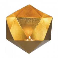 Your wall will sparkle and shine with stunning design when you hang this geometric golden wall sconce. The gold exterior and faceted metallic gold interior of this modern wall-mounted candle holder wi